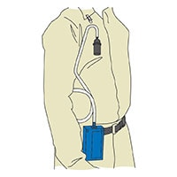 Cassette attached to worker's clothing in breathing zone. Personal sampling pump clipped to trouser belt.