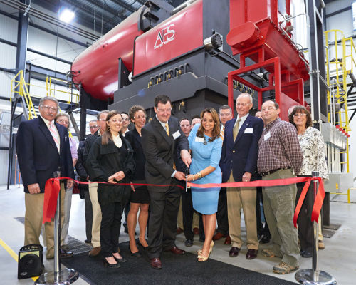 Tackling Global Challenges - Creating a culture of responsibility. Ribbon-cutting ceremony at our new Biomass Heat Plant in Jaffrey, New Hampshire.